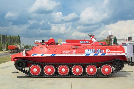 terrain: KUBINKA, MOSCOW OBLAST, RUSSIA - JUN 15, 2015: International military-technical forum ARMY-2015 in military-Patriotic park. Fire machine all-terrain vehicle on tracks to extinguish fires in hazardous areas