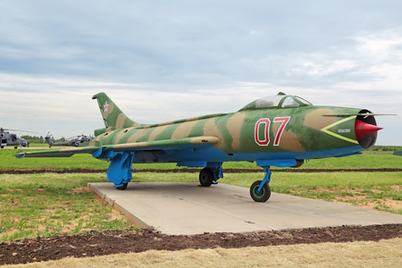 supersonic: KUBINKA, MOSCOW OBLAST, RUSSIA - JUN 19, 2015: The Sukhoi Su-7 (NATO designation name: Fitter-A)  is a retro supersonic fighter aircraft at the International military-technical forum ARMY-2015 at the Kubinka air base Editorial