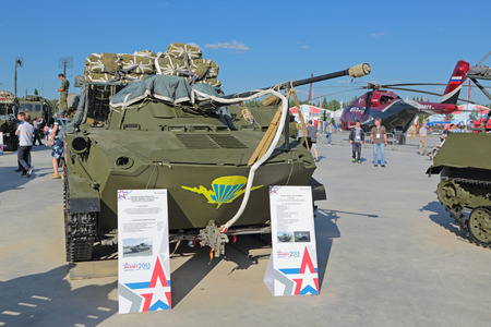 airborne vehicle: KUBINKA, MOSCOW OBLAST, RUSSIA - JUN 18, 2015: International military-technical forum ARMY-2015 in military-Patriotic park. The Combat Vehicle of the Airborne BMD-2 with a parachute (amphibious infantry fighting vehicle)