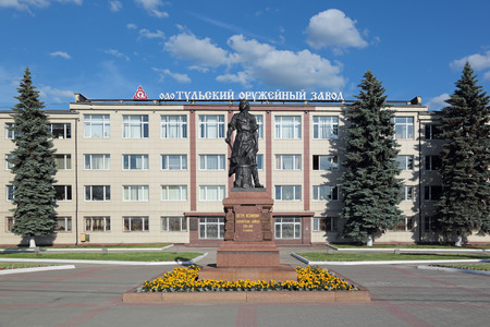 famous industries: TULA, RUSSIA - JUN 13, 2015: The monument to the Tsar of All Russia Peter the Great about famous building of the Tula Arms Plant Editorial