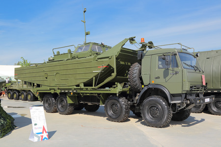 motor launch: KUBINKA, MOSCOW OBLAST, RUSSIA - JUN 19, 2015: International military-technical forum ARMY-2015 in military-Patriotic park. Towing motorboat BMK-460