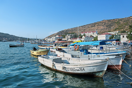 black moor: BALAKLAVA, SEVASTOPOL CITY, REPUBLIC OF CRIMEA, RUSSIA - AUG 10, 2014: Yachts and boats at the pier in Balaklava Bay Editorial