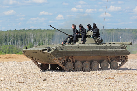 self testing: MILITARY GROUND ALABINO, MOSCOW OBLAST, RUSSIA - JUN 18, 2015: The BMP-2 (infantry combat vehicle) is a second-generation, amphibious infantry fighting vehicle at the International military-technical forum ARMY-2015
