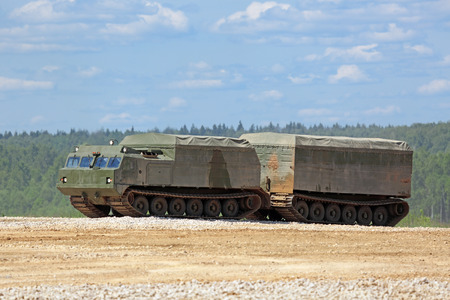 self testing: MILITARY GROUND ALABINO, MOSCOW OBLAST, RUSSIA - JUN 18, 2015: The two-tier tracked all-terrain amphibian vehicle at the International military-technical forum ARMY-2015