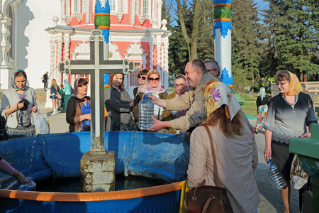 temple tank: MOSCOW REGION, SERGIYEV POSAD, RUSSIA - MAY 1, 2014: Trinity Lavra of St. Sergius - the largest Orthodox male monastery in Russia. Water chapel-canopy, parishioners are gaining Holy water