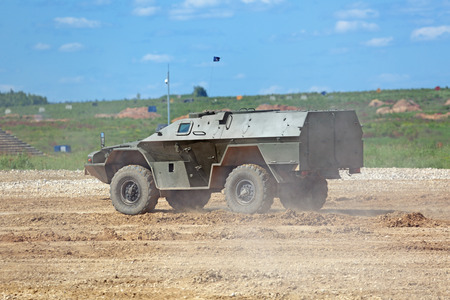 capabilities: MILITARY GROUND ALABINO, MOSCOW OBLAST, RUSSIA - JUN 18, 2015: The demonstration of the capabilities of a military armored car KAMAZ at the International military-technical forum ARMY-2015