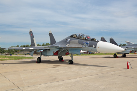 twin engine: KUBINKA, MOSCOW OBLAST, RUSSIA - JUN 19, 2015: The Sukhoi Su-30 (NATO designation name: Flanker-C) is a russian modern twin-engine, two-seat supermaneuverable supersonic fighter aircraft at the International military-technical forum ARMY-2015 at the Kubin