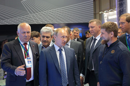 the statesman: ZHUKOVSKY, MOSCOW REGION, RUSSIA - AUG 25, 2015: The CEO of Rostec Corporation Sergey Chemezov, President of the Russian Federation Vladimir Putin and President of the Chechen Republic Ramzan Kadyrov at the International Aviation and Space salon MAKS-2015