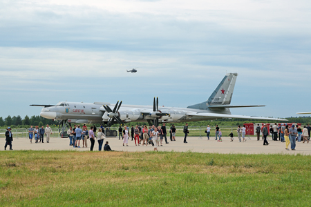 engine powered: KUBINKA, MOSCOW OBLAST, RUSSIA - JUN 19, 2015: International military-technical forum ARMY-2015 at the Kubinka air base. The Tupolev Tu-95 (Bear) is a large, four-engine turboprop-powered strategic bomber and missile platform