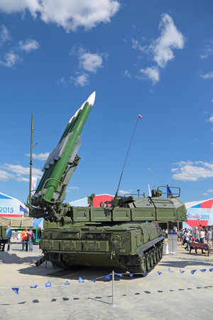 gadfly: KUBINKA, MOSCOW OBLAST, RUSSIA - JUN 18, 2015: International military-technical forum ARMY-2015 in military-Patriotic park. The Buk (SA-11 Gadfly)- russian self-propelled, medium-range surface-to-air missile system Editorial