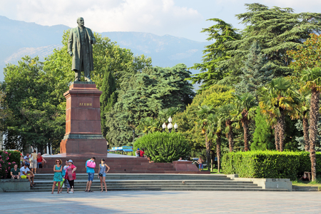 theorist: YALTA, REPUBLIC OF CRIMEA, RUSSIA - AUG 17, 2014: Cityscape, the monument to a Russian communist revolutionary, politician and political theorist Vladimir Lenin in the city centre, was opened in 1954