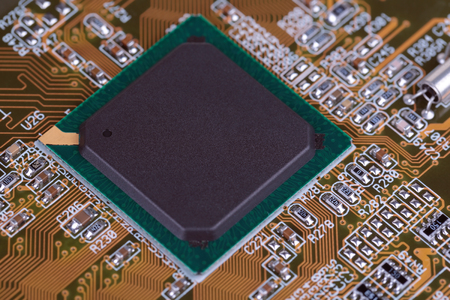 internals: Fragment of the printed-circuit board of the computer with an integrated microcircuit Stock Photo