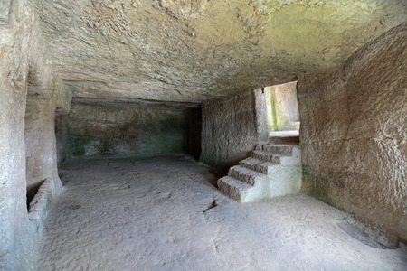 jewish home: Medieval cave city-fortress Chufut-Kale, Bakhchysarai, Republic of Crimea, Russia. Carved into the rock of the premises Stock Photo