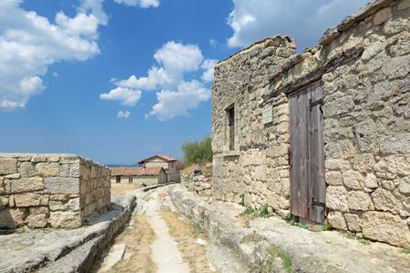 jewish home: Manor Solomon Bame (Chal-Boryu, Gray Wolf) XVIII century in medieval cave city-fortress Chufut-Kale, main street, Bakhchysarai, Republic of Crimea, Russia