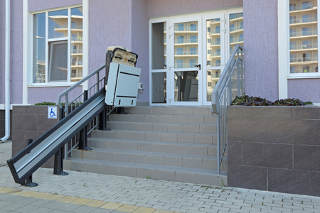 disablement: The special Elevator for the disabled at the entrance to the shop Stock Photo