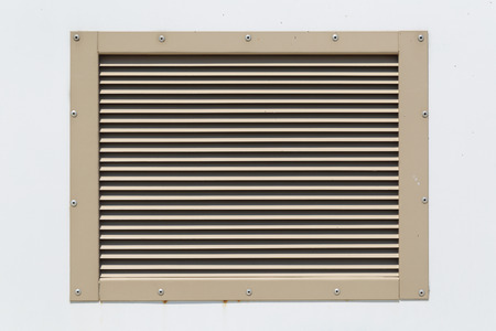 grille: Outdoor ventilation grille on the wall of a building