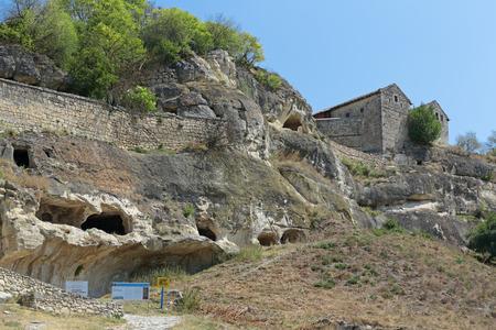 jewish houses: BAKHCHYSARAI, REPUBLIC OF CRIMEA, RUSSIA - AUG 12, 2014: Medieval cave city-fortress Chufut-Kale. Crimean Karaites Kenassas XVI and XVIII century Editorial