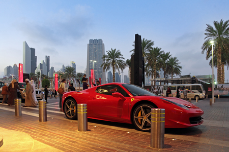 DUBAI, UNITED ARAB EMIRATES, - FEB 05, 2014: Ferrari 458 Spider parked on the street in the evening city