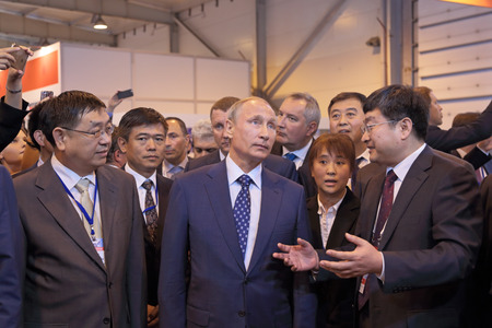 Delegation: ZHUKOVSKY, MOSCOW REGION, RUSSIA - AUG 25, 2015: The President of the Russian Federation Vladimir Vladimirovich Putin with Chinese delegation at the International Aviation and Space salon MAKS-2015