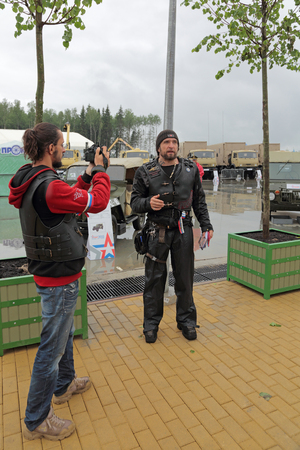 activist: KUBINKA, MOSCOW OBLAST, RUSSIA - JUN 16, 2015: Alexander Zaldostanov, also known as Surgeon, is a leader Russian largest motorcycle club Night Wolves, political activist at the International military-technical forum ARMY-2015 in military-Patriotic par Editorial