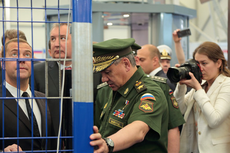 minister: KUBINKA, MOSCOW OBLAST, RUSSIA - JUN 16, 2015: The Prime Minister Dmitry Medvedev, Deputy Prime Minister Dmitry Rogozin and Minister of Defense Sergey Shoygu at the International military-technical forum ARMY-2015 in military-Patriotic park