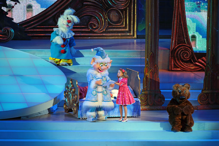 actors: MOSCOW, RUSSIA - DEC 27, 2014: Childrens Christmas show in State Kremlin Palace in Moscow Kremlin. The actors on the stage