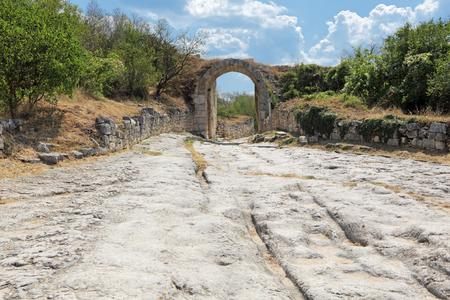 orta: Medieval cave city-fortress Chufut-Kale, Bakhchysarai, Republic of Crimea, Russia. Gate average defensive wall (Orta Kapu)