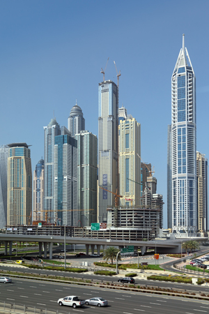 DUBAI, UNITED ARAB EMIRATES, - FEB 05, 2014: Cityscape, view of the road and modern skyscrapers