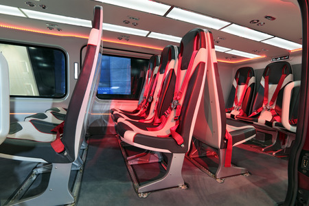 luxuriance: Salon of the modern passenger helicopter with comfortable chairs and seat belt Stock Photo
