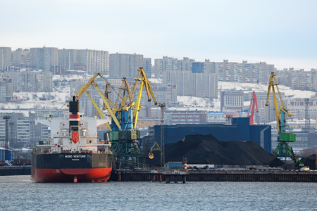 MURMANSK, RUSSIA - FEB 21, 2016: The cityscape, view of the sea commercial port and coal terminal