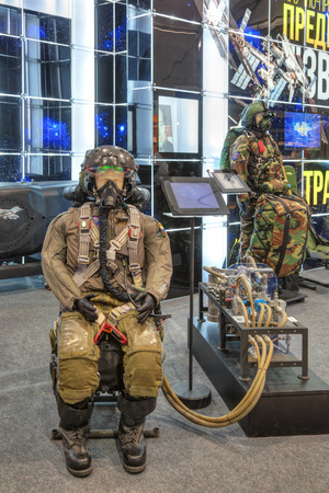 ZHUKOVSKY, RUSSIA - AUG 30, 2015: Stand of Research & Development Production Enterprise Zvezda. The complete equipment of the pilot - anti-g suit ejection seat and without balloon oxygen system at the International Aviation and Space salon MAKS-2015