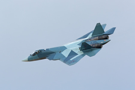 frontline: ZHUKOVSKY, MOSCOW REGION, RUSSIA - AUG 30, 2015: Flight demonstration Sukhoi PAK FA T-50 (Prospective Airborne Complex of Frontline Aviation) fifth-generation jet fighter at the International Aviation and Space salon MAKS-2015 Editorial