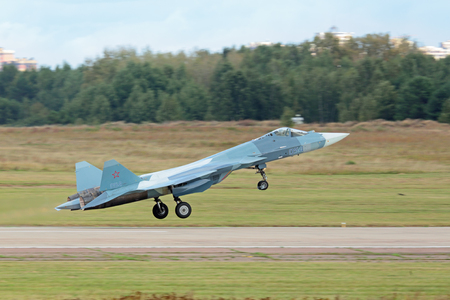 ZHUKOVSKY, MOSCOW REGION, RUSSIA - AUG 30, 2015: Takeoff Sukhoi PAK FA T-50 (Prospective Airborne Complex of Frontline Aviation) fifth-generation jet fighter at the International Aviation and Space salon MAKS-2015 Editorial