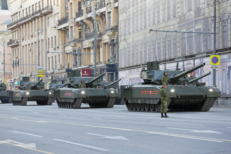 convoy: MOSCOW, RUSSIA - MAY 05, 2016: Rehearsal celebration of the 71th anniversary of the Victory Day (WWII). Military equipment on Tverskaya street prepares to travel to the Red Square. The convoy T-14 Armata is a new Russian main battle tank based on the Arma