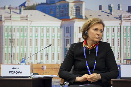 head protection: SAINT-PETERSBURG, RUSSIA - JUN 16, 2016: St. Petersburg International Economic Forum SPIEF-2016. Anna Popova, Head of the Federal Service for Surveillance on Consumer Rights Protection and Human Wellbeing; Chief State Sanitary Physician of the Russian Fed