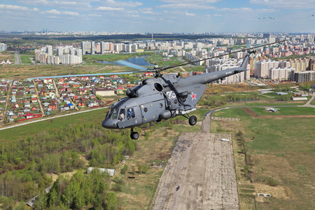 KUBINKA, MOSCOW REGION, RUSSIA - MAY 05, 2015: Russian Mil Mi-8 helicopter returned to the airfield Kubinka after participating in the rehearsals of the passage of aircraft in the parade in honor of Victory Day in WWII