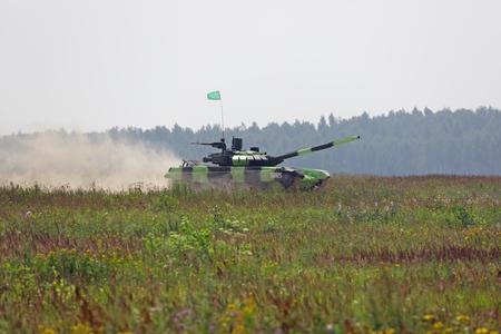 TRAINING GROUND ALABINO, MOSCOW REGION, RUSSIA - AUG 06, 2016: The international army games - 2016. Tank biathlon Editorial