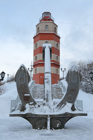 MURMANSK, RUSSIA - FEB 16, 2016: A memorial to the sailors who died in peacetime - ship anchor and hexagonal tower lighthouse Editorial