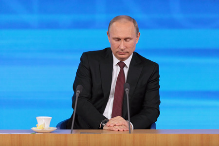 MOSCOW, RUSSIA - DEC 19, 2013: The President of the Russian Federation Vladimir Vladimirovich Putin with eyes closed annual press conference in Center of international trade Editorial