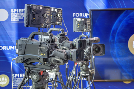 lens unit: SAINT-PETERSBURG, RUSSIA - JUN 18, 2016: St. Petersburg International Economic Forum SPIEF-2016. Professional video cameras on tripods