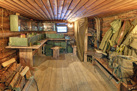 KUBINKA, MOSCOW OBLAST, RUSSIA - JUL 04, 2016: Military-patriotic park Patriot. Reconstruction of a partisan village of the WWII - School of saboteur (dugout)