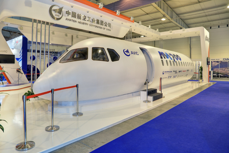 promising: ZHUKOVSKY, MOSCOW REGION, RUSSIA - AUG 28, 2015: International Aviation and Space salon MAKS-2015. The stand of the Chinese company AVIC International. Layout promising airliner ММ700 Editorial