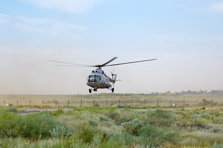 ASHULUK TRAINING AREA, ASTRAKHAN REGION, RUSSIA - AUG 07, 2016: The international army games - 2016. The contest Keys to the sky. Landing a helicopter Mil Mi-8 (NATO reporting name: Hip) on the ground Editorial