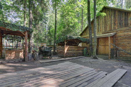 guerilla: KUBINKA, MOSCOW OBLAST, RUSSIA - JUL 04, 2016: Military-patriotic park Patriot. Reconstruction of a partisan village in the forest of the WWII