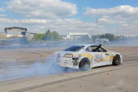 sportcar: ZHUKOVSKY, MOSCOW REGION, RUSSIA - AUG 28, 2015: Drift show in the advertising of the manufacturer of tires Yokohama at the International Aviation and Space salon MAKS-2015