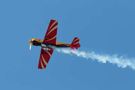 ZHUKOVSKY, MOSCOW REGION, RUSSIA - AUG 29, 2015: A demonstration flight of the aerobatic team First flight on Yakovlev Yak-52 plane at the International Aviation and Space salon MAKS-2015