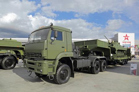 flatcar: KUBINKA, MOSCOW OBLAST, RUSSIA - SEP 06, 2016: International military-technical forum ARMY-2016. KamAz-65225 with semitrailer for transportation of heavy military equipment