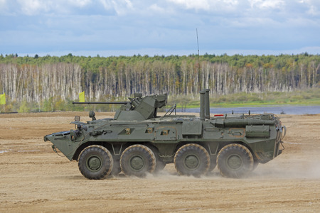 manoeuvre: MILITARY GROUND ALABINO, MOSCOW OBLAST, RUSSIA - SEP 10, 2016: The BTR-82a is a Russian 8x8 wheeled amphibious armoured personnel carrier (APC) at the International military-technical forum ARMY-2016 Editorial