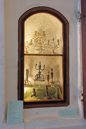 antiquities: ROSTOV, YAROSLAVL OBLAST, RUSSIA - MAY 02, 2014: White dining room chamber (the Museum of Church antiquities) on the territory of the Rostov Kremlin (Golden Ring). Vintage candlesticks Editorial