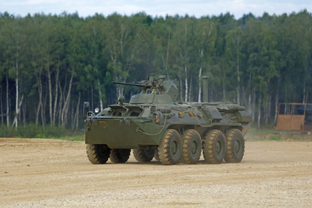 weaponry: MILITARY GROUND ALABINO, MOSCOW OBLAST, RUSSIA - SEP 10, 2016: The BTR-82a is a Russian 8x8 wheeled amphibious armoured personnel carrier (APC) at the International military-technical forum ARMY-2016 Editorial